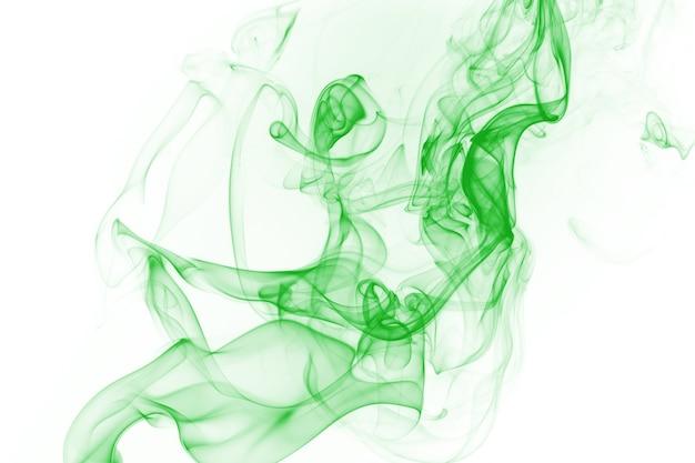 Résumé de mouvement de fumée verte sur fond blanc
