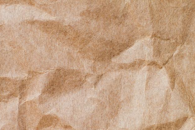 Résumé papier recyclé brun froissé pour le fond: pli de papier brun pour la conception, décoratif.