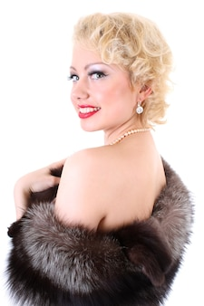 Retro portrait of young beautiful blondie woman with col fourrure