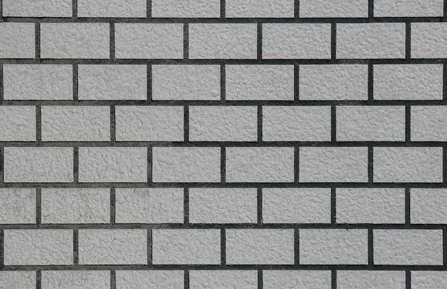 Retro tanné vieux fond de texture de la surface de la brique grise pile mur clôture.