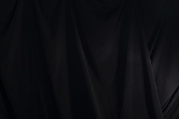 Rideau noir drapé vague, fond d'écran texture détail