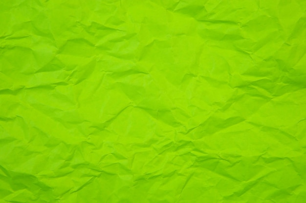 Rides vertes froissées vieux avec fond de page papier texture rugueux. pli grunge parchemin modèle vintage