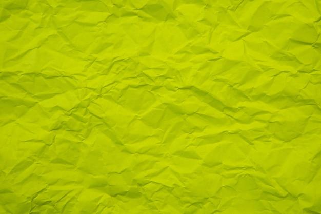 Rides vertes froissées vieux avec fond de page papier texture rugueux. pli grunge parchemin motif design vintage