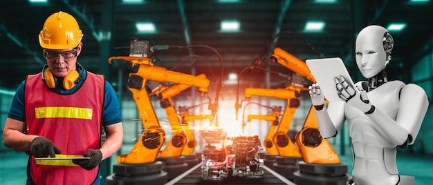 Robot industriel mécanisé et travailleur humain travaillant ensemble dans la future usine