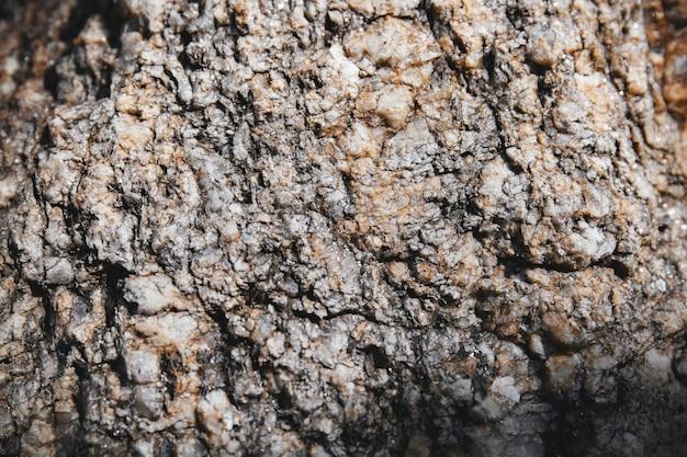Rock texturé gros plan avec petit morceau de paillettes sur la surface.