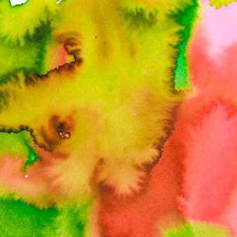 Rouge vif; fond texturé aquarelle mélangé jaune et vert