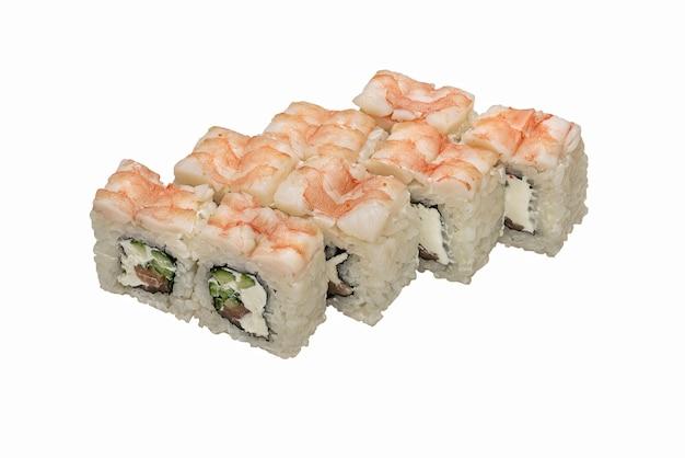 Rouleaux - sushi avec dessus de crevettes.