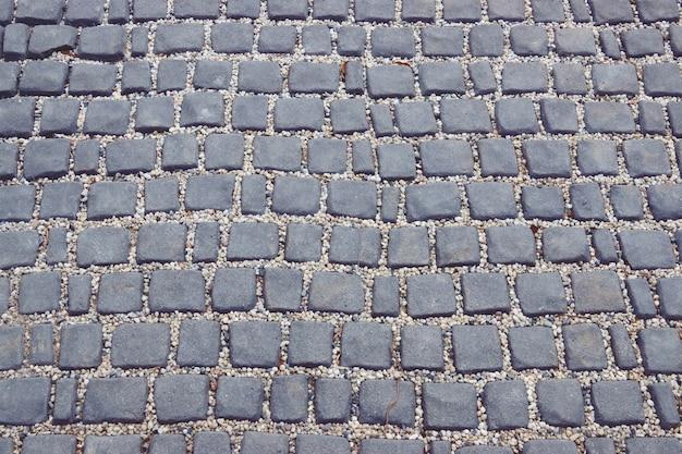 Route faite de carreaux de pierre. texture abstraite pour modèle