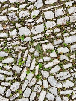 Route de pierre ancienne, texture, arrière-plan, vierge pour la conception.