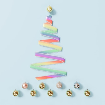 Ruban arc-en-ciel objets de décoration du jour de noël en forme d'arbre de noël sur bleu idée minimale. rendu 3d.