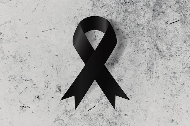 Ruban noir au sol symbole du souvenir ou du deuil commémorant