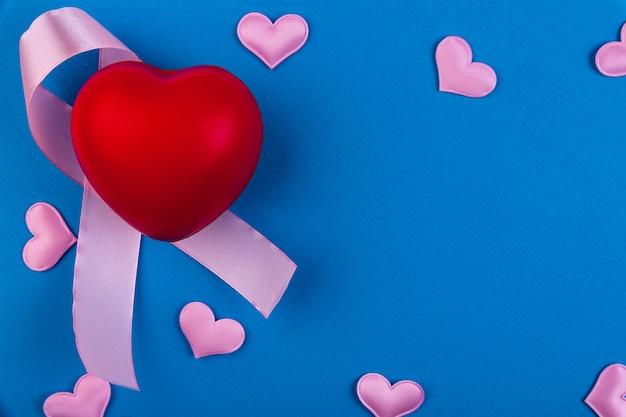 Ruban rose sensibilisation au cancer du sein couleur de l'arc symbolique augmentant le soutien des personnes atteintes d'une tumeur du sein chez les femmes