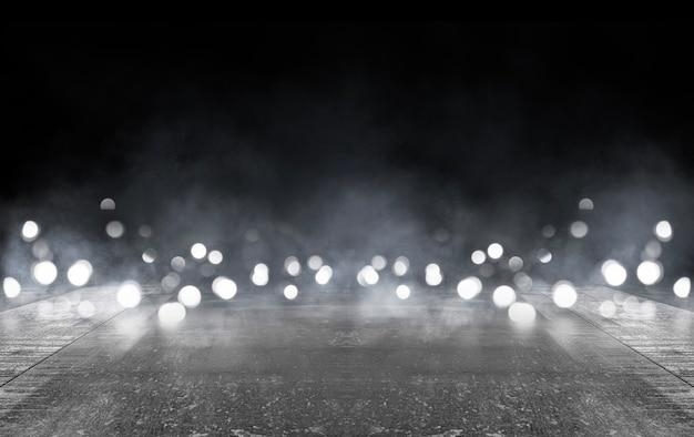 Rue sombre, asphalte mouillé, reflets des rayons
