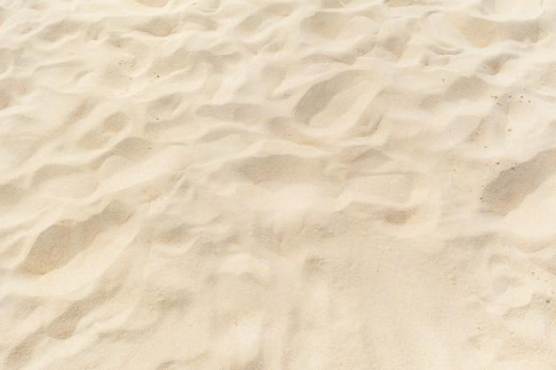 Sable fin de plage au soleil d'été