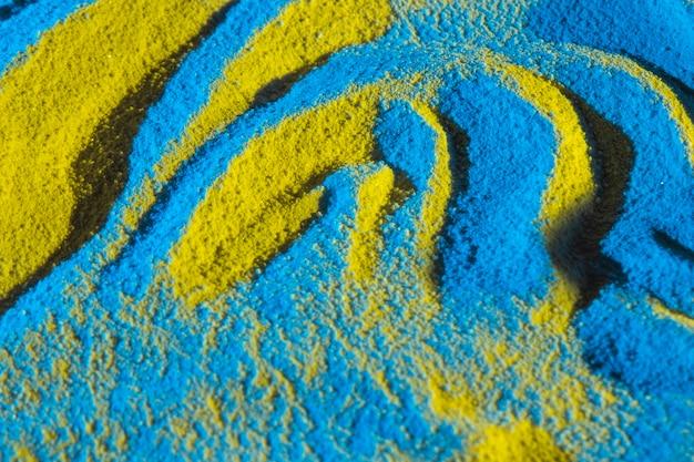 Le sable forme au hasard la vue de dessus