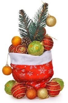 Sac cadeau santas rempli de jouets avec une branche d'arbre de noël