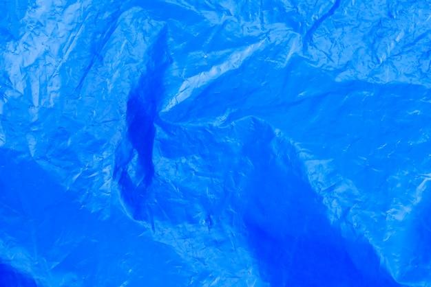 Sac poubelle bleu texture abstraite fond film plastique froissé
