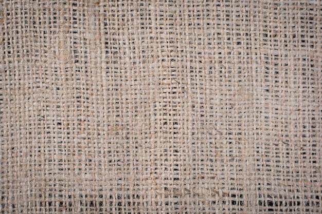 Un sac de toile de jute tissé texture de fond dans des tons de couleur crème beige clair marron