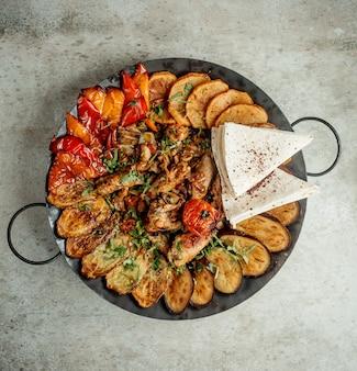 Sadj aux aubergines de poulet et tomates
