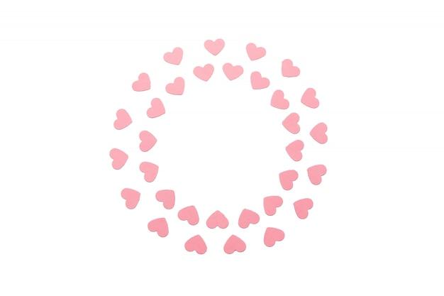 Saint valentin autour de cadre composé de coeurs de papier rose