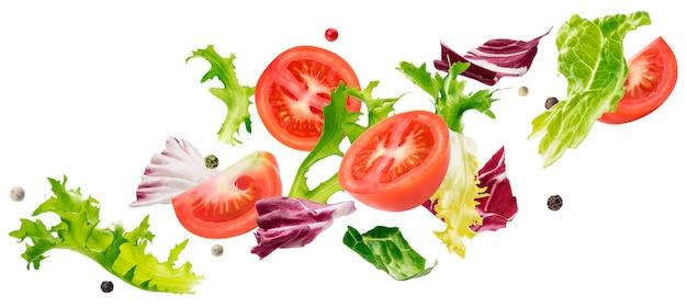 Salade de feuilles tombantes avec roquette, laitue, radicchio, frise verte romano et tomates