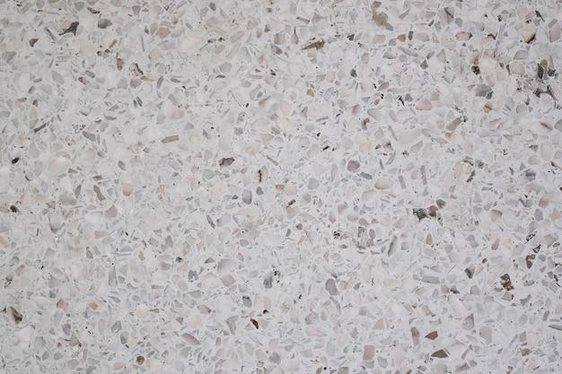 Sale et poussière sur le sol et le mur en pierre polie terrazzo