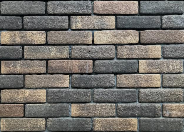 Sale vieux fond de texture de mur de brique de couleur sombre aléatoire aléatoire.