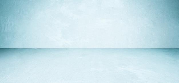 Salle de béton bleu vide et fond de sol