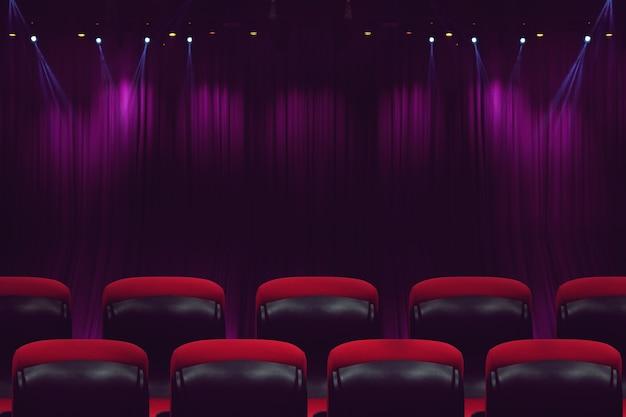 Salle de cinéma ou salle de cinéma vide avec sièges rouges avant l'heure du spectacle