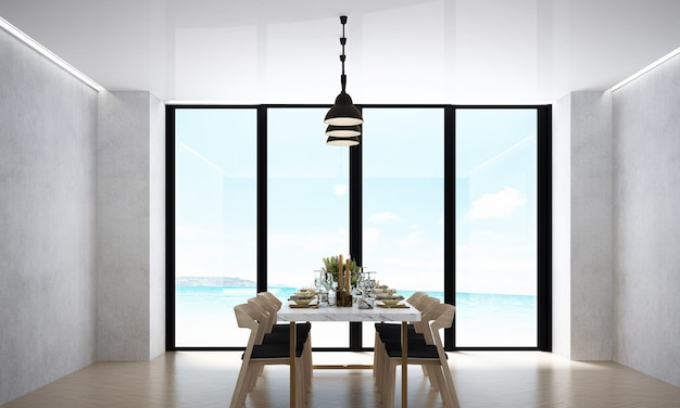 La salle à manger moderne et la décoration de meubles simulés et le fond de mur blanc et la vue sur la mer