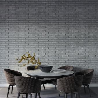 Salle à manger avec table devant le mur de briques