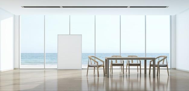 Salle à manger vue mer dans maison moderne avec cadre photo.