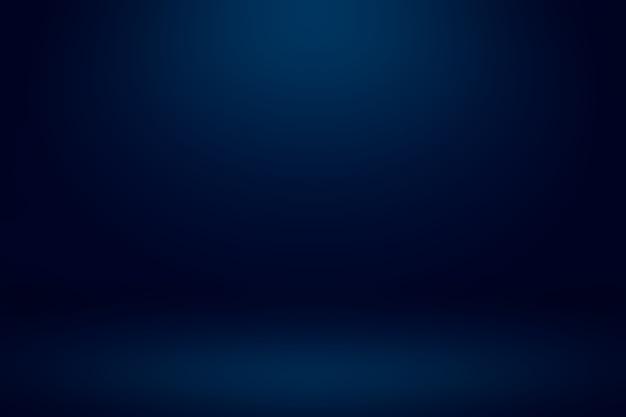 Salle de studio bleu foncé vide avec fond abstrait lumière et ombre