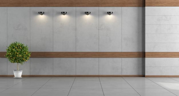 Salle vide avec murs en béton et cadres en bois