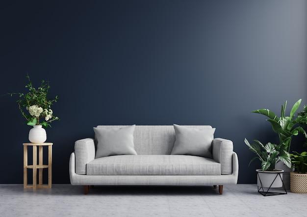 Le salon aux murs bleu foncé est vide, décoré de plantes et de canapés sur des sols carrelés.