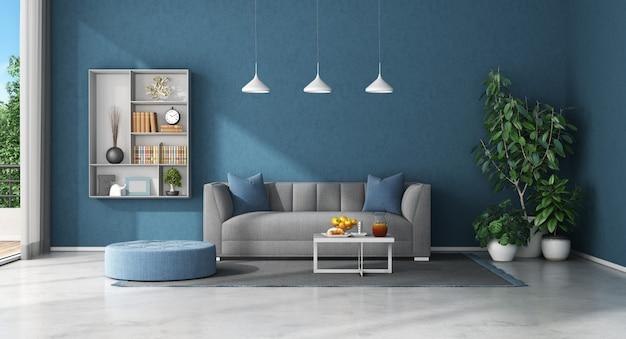 Salon bleu avec canapé et bibliothèque