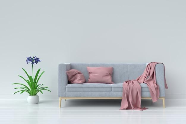 Salon avec canapé en velours et oreiller rose sur fond de mur blanc vide