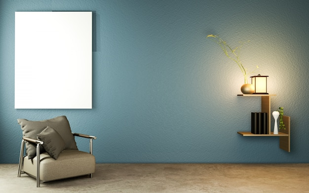Salon chambre bleu foncé de style japonais avec table en bois, lampes et fauteuil sur sol béton.