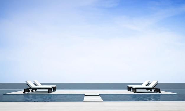 Le salon extérieur moderne et confortable et la décoration de meubles de lit de repos et l'arrière-plan de la vue sur la mer