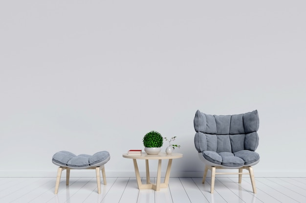 Salon avec fauteuils et un bureau pour placer des livres