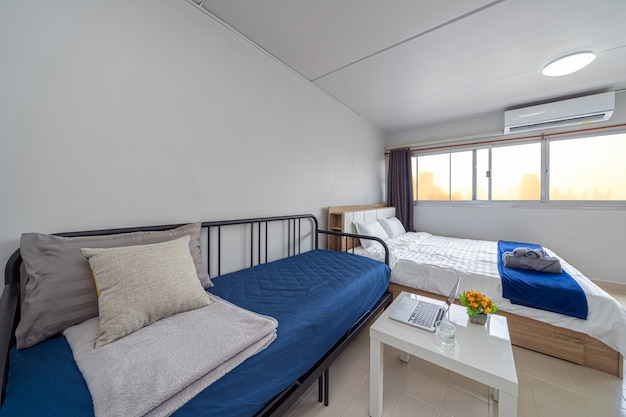 Salon intérieur de luxe, canapé-lit, lit queen size, espace de travail fonctionnant