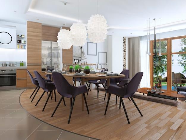 Salon moderne dans un style loft et se fondant en douceur dans la cuisine salle à manger avec grand canapé d'angle et étagères avec décorations et chaise moelleuse avec un lampadaire.