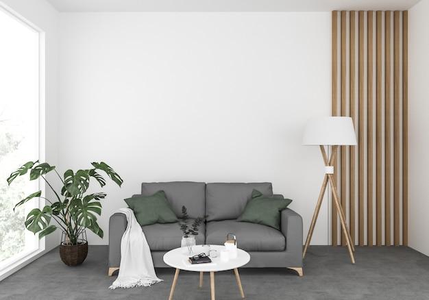 Salon scandinave avec un canapé gris, maquette de mur blanc, présentoir d'art mural