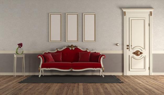 Salon de style rétro avec canapé rouge élégant et doo classique