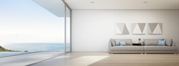 Salon vue sur la mer de la maison de plage d'été de luxe avec piscine et terrasse en bois.