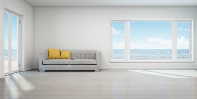 Salon vue mer, maison de plage avec intérieur vintage blanc.