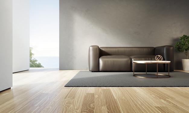 Salon vue mer de maison de plage de luxe avec canapé noir sur plancher en bois.