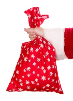 Santa claus hand holding sac de cadeaux isolated on white