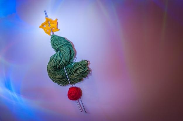 Sapin de noël alternatif en laine avec aurores boréales