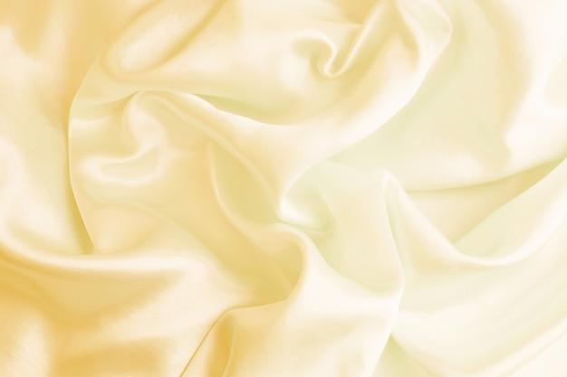 Satin luxueux de belle texture de soie crème pour abstrait. mise au point douce